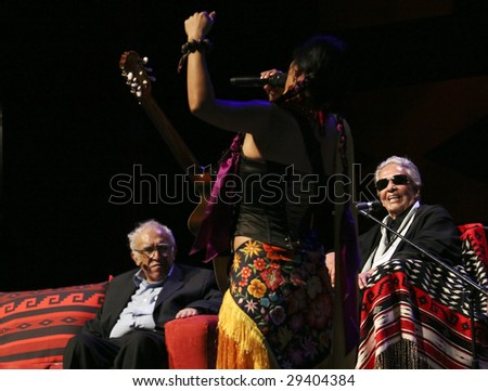 MEXICO CITY - APRIL 21 : Carlos Monsivais (L) and Chavela Vargas (R) look at the singer Lila Downs (C) during the Chavela Vargas 90th Anniversary homage on April 21, 2009 in Mexico City, Mexico.