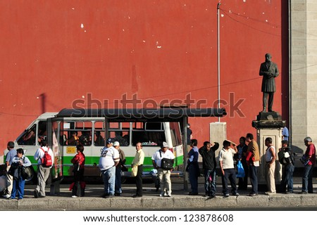 MEXICO CITY-FEB 25:Line of Mexican people in public transportation station in Mexico City on February 25 2010.It's the second busiest publicly owned transit system in North America after New York City