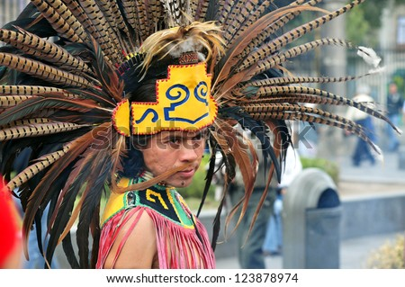 MEXICO CITY-FEB 23:Portrait of Male Aztec Indian wearing traditional clothing and headdressat the Zocalo Square on February 23 2010 in Mexico City.Since 1982 the Zocalo become cultural events center