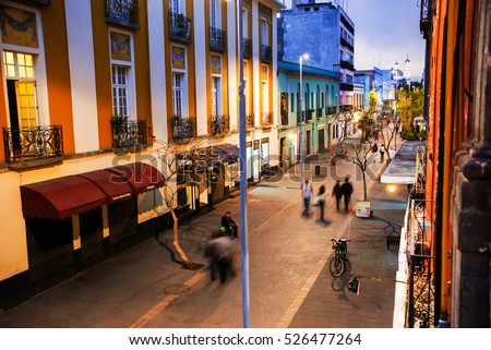 Mexico City is the capital of Mexico. Nightlife in Mexico City. Streets of the center with blurred people, bars, restaurants and cafes. #526477264