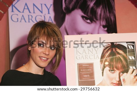 "MEXICO CITY - NOV 19: Singer Kany Garcia celebrates for her two Latin Grammy Awards and Gold Disc for high sales of her new cd album ""Cualquier dia"" (Any day) November 19, 2008 in Mexico City."