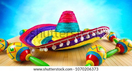 Mexico.Colored sombrero and maracas on a wooden background. #1070206373