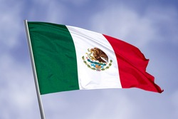 Mexico flag isolated on sky background. close up waving flag of Mexico. flag symbols of Mexico.