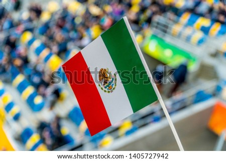 Mexico flag waving during football/soccer match.  #1405727942