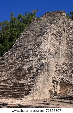 "Mexico ""Quintana Roo"" state Coba Mayan archaeological site - the Nohoch Mul Pyramid sprouts from the surrounding jungle"