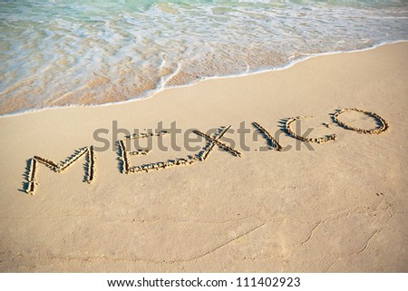 Mexico sign on the beach of Caribbean Sea