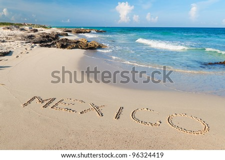 Mexico sign on the beach of Caribbean Sea