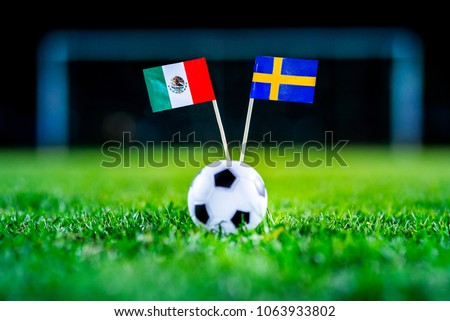 Mexico - Sweden, Group F, Wednesday, 27. June, Football, World Cup, Russia 2018, National Flags on green grass, white football ball on ground. #1063933802