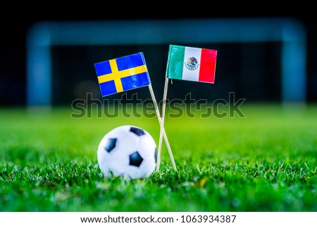 Mexico - Sweden, Group F, Wednesday, 27. June, Football, World Cup, Russia 2018, National Flags on green grass, white football ball on ground. #1063934387
