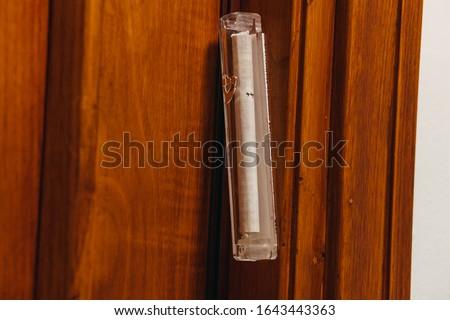 Mezuzah door jamb. Attaches to an external door jamb in a Jewish house. Photo stock ©