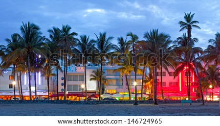 Miami Beach, Florida  hotels and restaurants at sunset on Ocean Drive, world famous destination for it\'s nightlife, beautiful weather, Art Deco architecture and pristine beaches