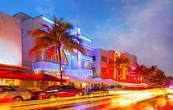 Miami Beach, Florida illuminated hotels and restaurants at sunset on Ocean Drive, world famous destination for nightlife, beautiful weather and pristine beaches