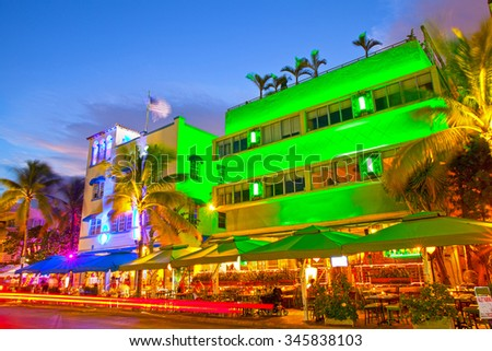 Miami Beach, Florida Moving traffic hotels and restaurants at sunset on Ocean Drive, world famous destination for it\'s nightlife, beautiful summer  weather and pristine beaches