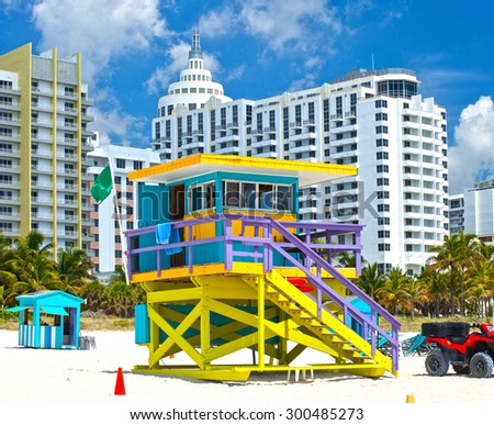 Miami Beach Florida, USA famous tropical travel location, typical Art Deco lifeguard house and hotels on a beautiful summer day