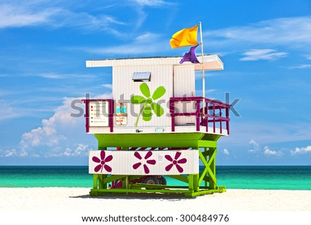 Miami Beach Florida, USA famous tropical travel location, typical Art Deco lifeguard house on a beautiful summer day with ocean and blue sky