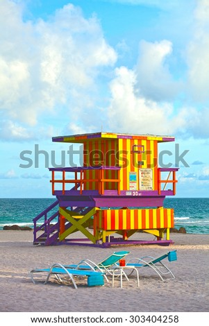 Miami Beach Florida, USA famous tropical travel location, typical Art Deco lifeguard house on a beautiful summer afternoon with ocean and blue sky