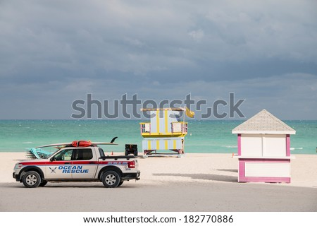 MIAMI BEACH - JANUARY 25, 2014: Pink beach hut with ocean and sand and ocean rescue truck taken on January 25, 2014 in Miami Beach, USA