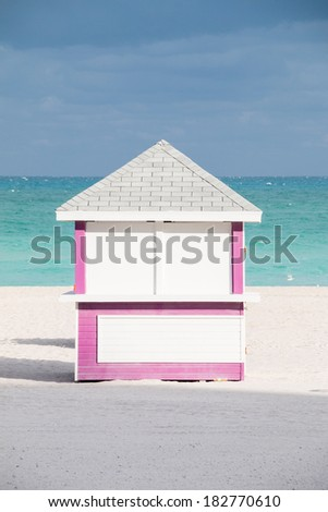 MIAMI BEACH - JANUARY 25, 2014: Pink beach hut with ocean and sand taken on January 25, 2014 in Miami Beach, USA