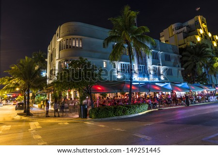 MIAMI BEACH - JULY 28: Night view at Ocean drive on July 28, 2013 in Miami Beach, Florida. Art Deco Night-Life in South Beach at Ocean Drive  is one of the main tourist attractions in Miami.