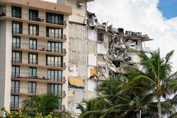 Miami Beach Surfside, FL, USA - June 26, 2021: Champlain Towers remains 2 days after collapse owners personal belongings visible hanging from the units