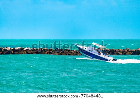 Miami Beach, USA-April 22, 2017: Nautical recreation in the tropical beach. The motor activities have a barrier that avoid entering in the beach area. The landmark is a tourist attraction.