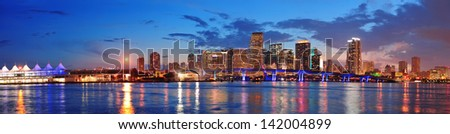 Miami city skyline panorama at dusk with urban skyscrapers and bridge over sea with reflection #142004899