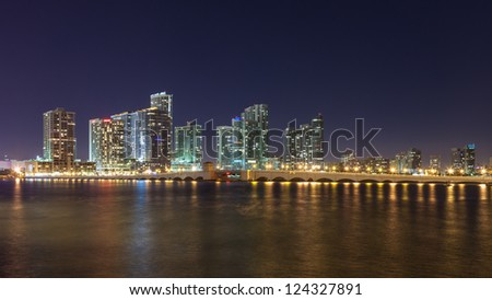 MIAMI - DEC 22: Miami skyline and the Venetian Causeway at night on December 22, 2012. Miami is the fourth largest urban area in the United States and a popular travel destination.