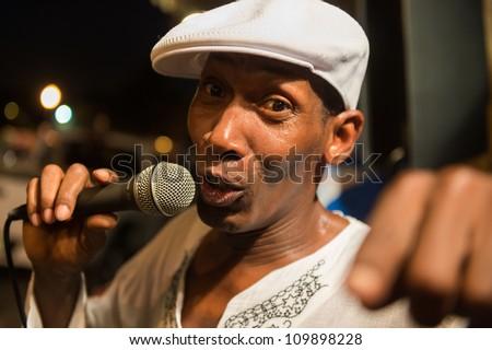 MIAMI, FL - CIRCA JULY 2012: Street performer singing  in Little Havana circa July 2012 in Miami,  during \