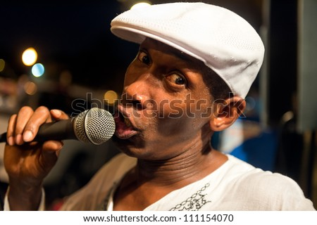 MIAMI, FL - CIRCA JULY 2012:Unidentified street performer sings in Little Havana circa July 2012 in Miami, during \