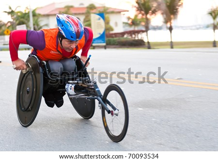 MIAMI, FL - JANUARY 30: An unidentified competitor racing in a wheelchair during the Miami Marathon on January 30, 2011 in Miami, Florida.