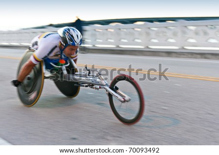 MIAMI, FL - JANUARY 30: Competitor Orlando Cortes, races in a wheekchair during the Miami Marathon. January 30, 2011 in Miami, Florida.