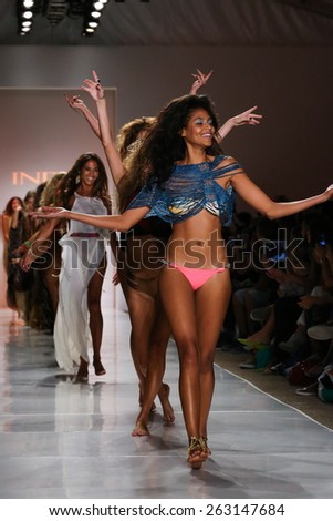 MIAMI, FL - JULY 21: Models walks runway finale at the Indah fashion show during MBFW Swim 2015 at The Raleigh hotel on July 21, 2014 in Miami, FL.