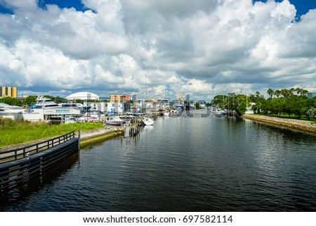 Miami, Florida - August 16, 2017: Scenic Miami River cityscape with marinas and boatyards along the Northwest Fifth Street drawbridge. #697582114