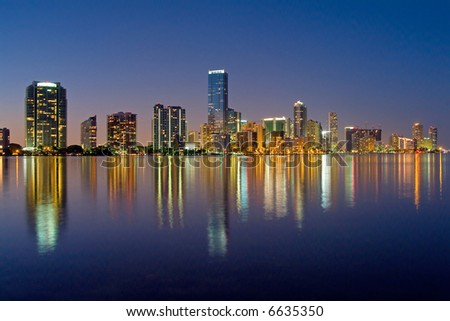 miami florida bayfront skyline at night (actual reflections in water)