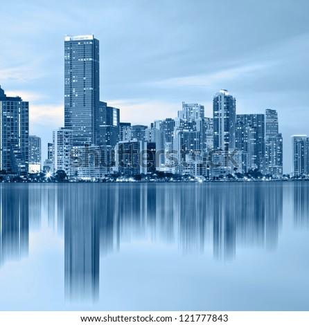 Miami Florida, downtown buildings, blue color processed photo with reflections in the Biscayne Bay water
