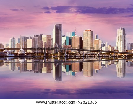 Miami Florida panorama of downtown residential and office buildings and hotels, with Biscayne bay water reflections and colorful sky on a beautiful day. Famous travel location.