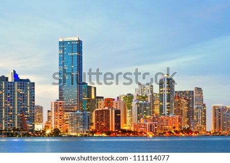 Miami Florida sunset over downtown illuminated business and luxury residential buildings and hotels. Cityscape of World famous travel location.