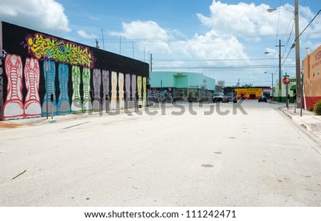 MIAMI, FLORIDA, USA - JUNE 28: Empty street in Wynwood, Miami on June 28,2012. Wynwood is an old warehousing district now converted into an arts district with building exteriors brightly painted.