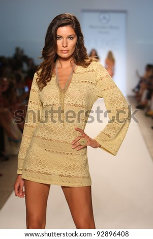 MIAMI - JULY 17: Model walking runway at the LUXE by Lisa Vogel Collection for Spring/ Summer 2012 during Mercedes-Benz Swim Fashion Week on July 17, 2011 in Miami, FL