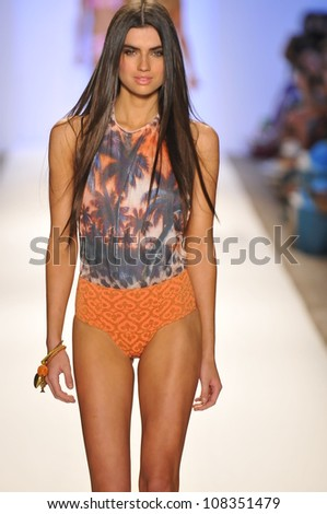 MIAMI - JULY 20: Model walks runway at the Cia Maritima Collection for Spring/ Summer 2013 during Mercedes-Benz Swim Fashion Week on July 20, 2012 in Miami, FL