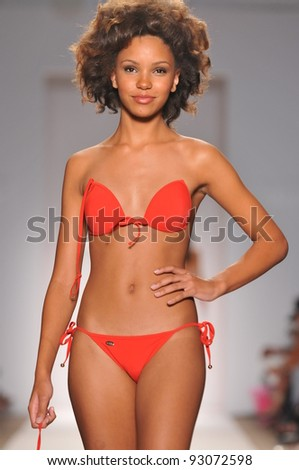stock photo : MIAMI - JULY 18: Model walks runway at the Perfect Tan Bikini