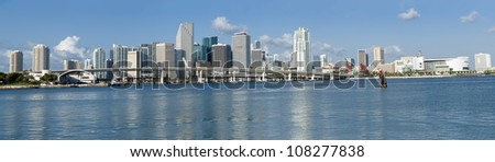 MIAMI - MAY 22: Panoramic view of Miami downtown skyline on May 22, 2011. Miami, Florida is a popular tourist destination, the beaches festivals and events draw over 38 million visitors annually into the city