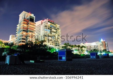 Miami south beach at night with hotel buildings