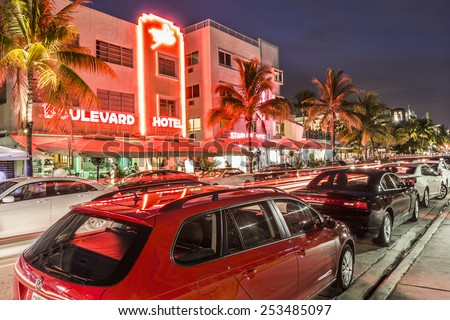 MIAMI, USA AUG 3, 2013: Night view at Ocean drive in Miami, USA. Art Deco Night-Life in South Beach at ocean drive is one of the main tourist attractions in Miami.