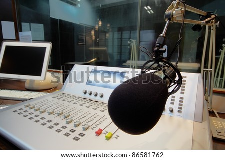 mic in front of the control panel in broadcasting studio