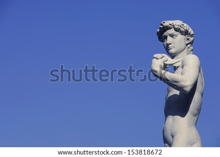 Michelangelo's David in the Piazza Della Signoria in the historical Renaissance city of Florence, Tuscany, Italy./ David in blue sky