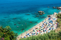Michelino beach in Parghelia near Tropea during summertime, Calabria, Italy. Sandy beach full of vacationers and colorful umbrellas