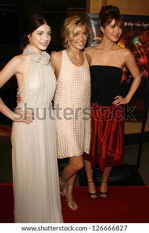 "Michelle Trachtenberg with Katie Cassidy and Mary Elizabeth Winstead at the Los Angeles Premiere of ""Black Christmas"". Mann's Chinese 6, Hollywood, California. December 19, 2006."