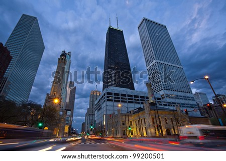Michigan Avenue in Chicago. Image of busy traffic at the street of Chicago during  sunset blue hour.
