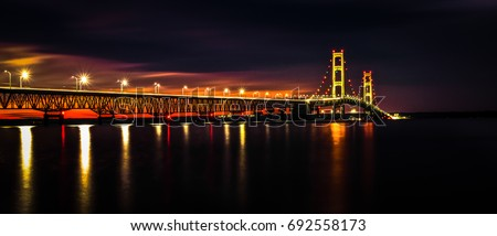 Michigan Mackinaw Bridge Illuminated Panorama. The Mackinaw Bridge is part of I-75 connects Michigan's Upper and Lower Peninsula's and is one of the longest suspension bridges in the world.